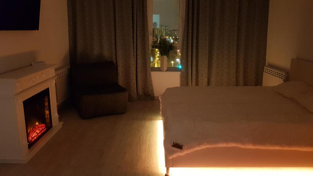A bed or beds in a room at Cozy apartment with panoramic view