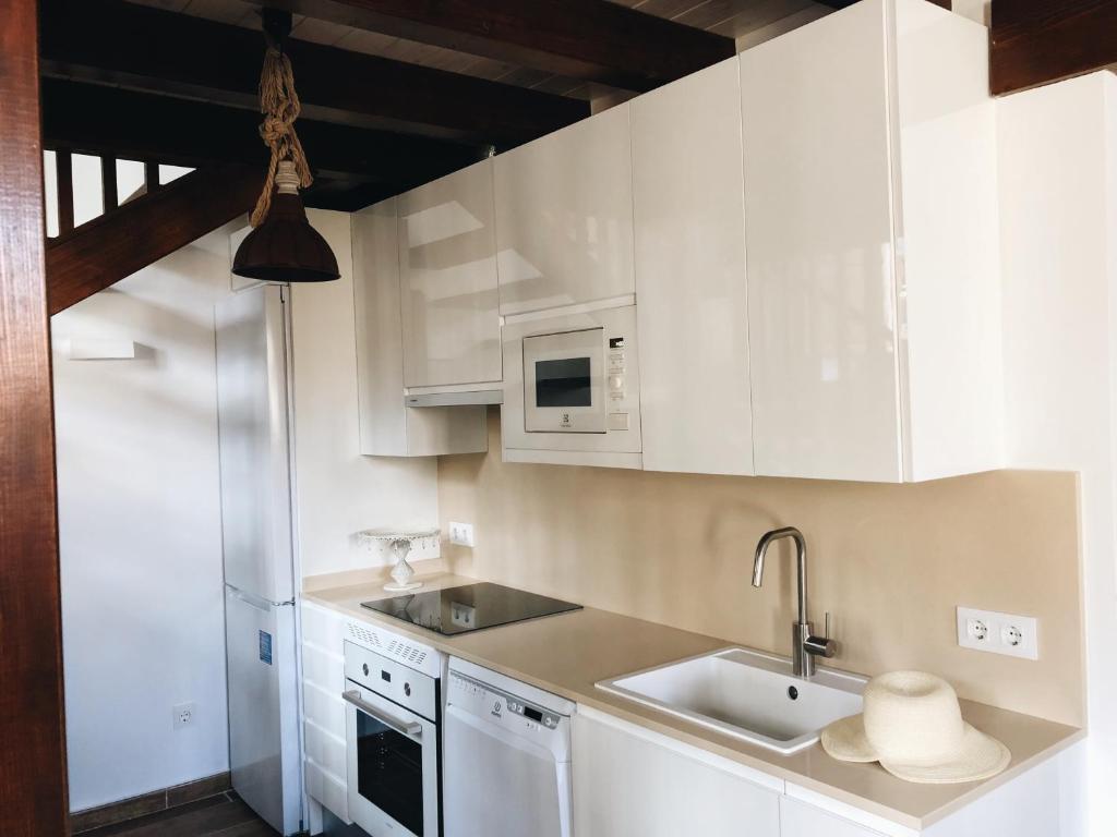Una cocina o zona de cocina en EL PAJAR DE LA ADRADA