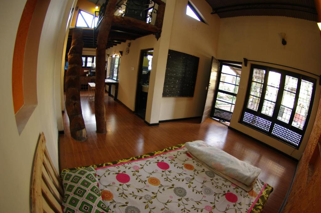 A bed or beds in a room at Laughing Buddha Home & Villa