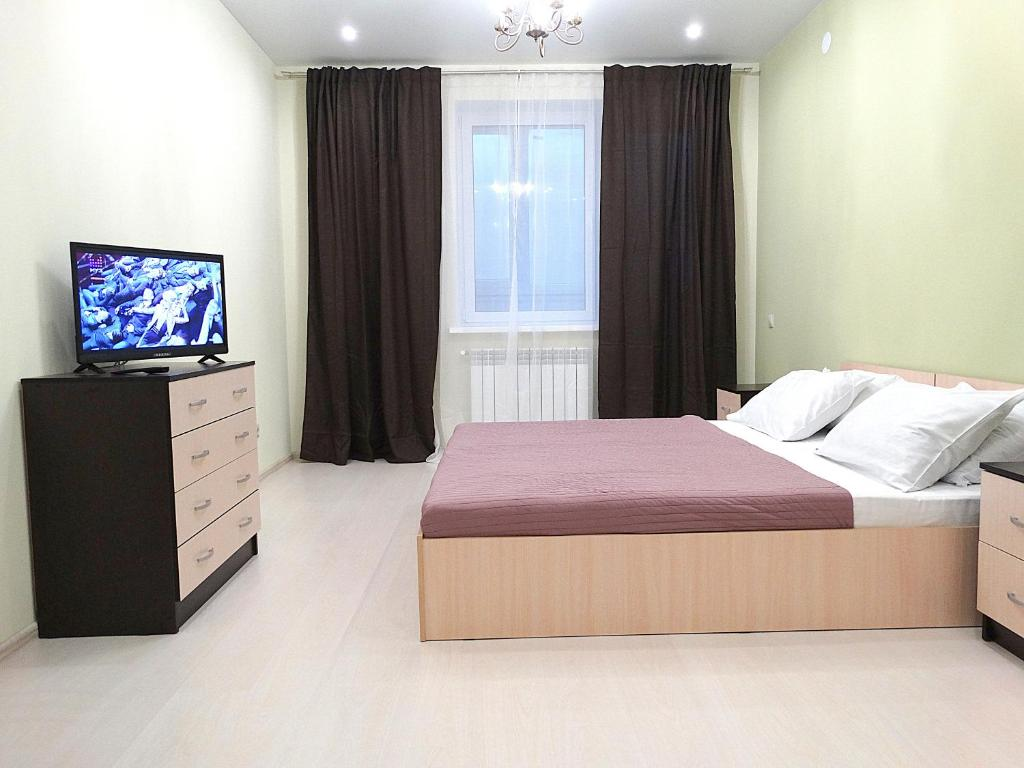 A bed or beds in a room at Inndays on Prospekt Lenina 132