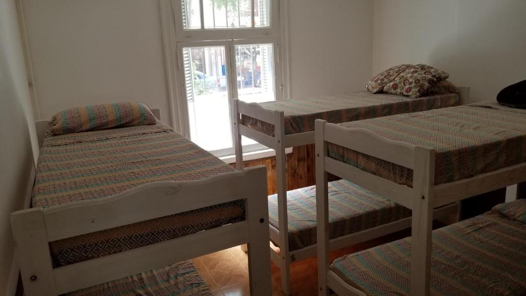 Una cama o camas cuchetas en una habitación  de Hostel Brown
