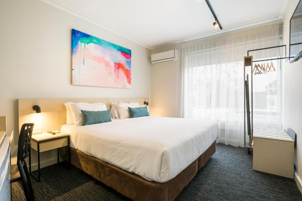 A bed or beds in a room at Nightcap at Playford Tavern