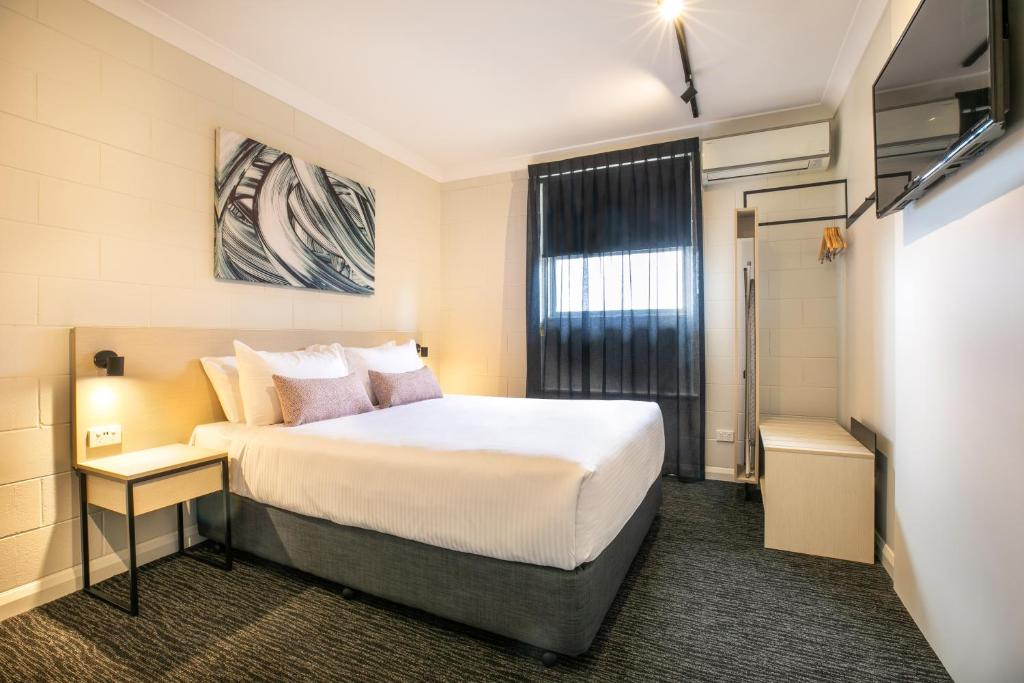 A bed or beds in a room at Nightcap at Hendon Hotel