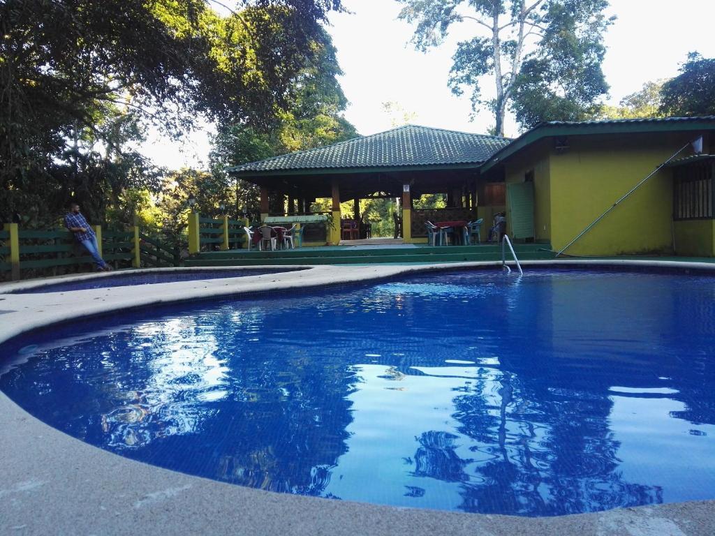The swimming pool at or near Hotel Rancho Las Cabañas