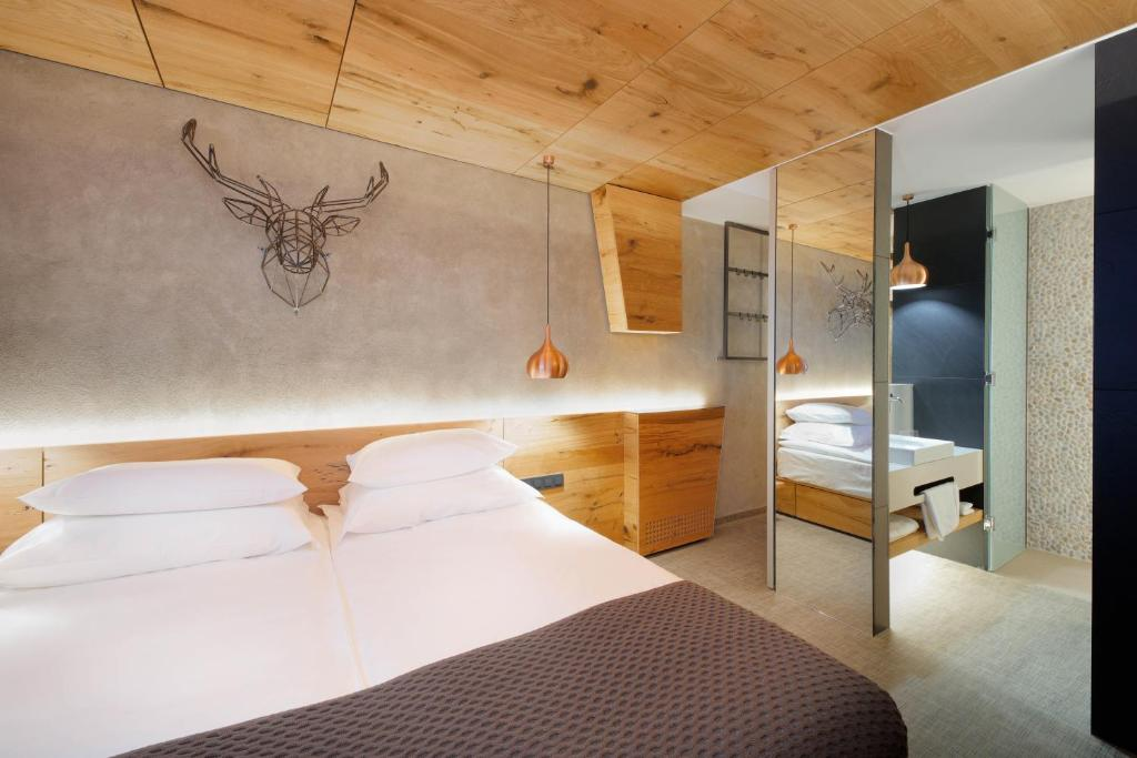 A bed or beds in a room at Rogla – Hotel Rogla