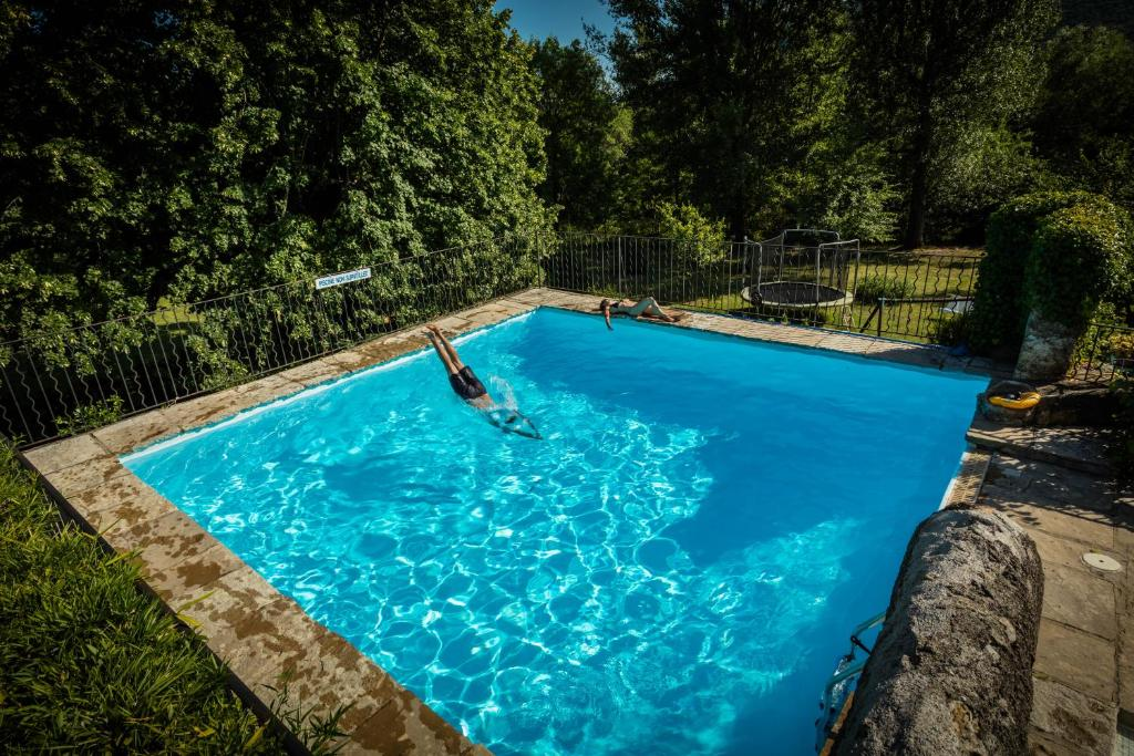 The swimming pool at or close to Les Logis des Magnans - Le Pagnol