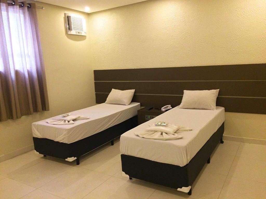 A bed or beds in a room at Rouge Hotel