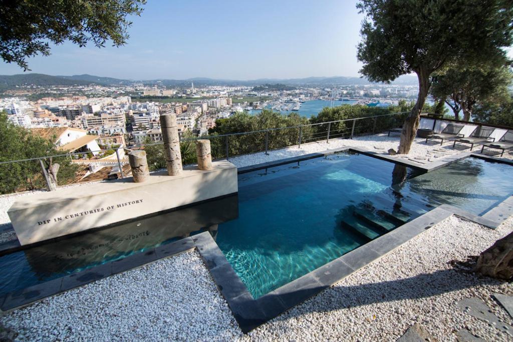 The swimming pool at or near Hotel La Torre del Canonigo - Small Luxury Hotels