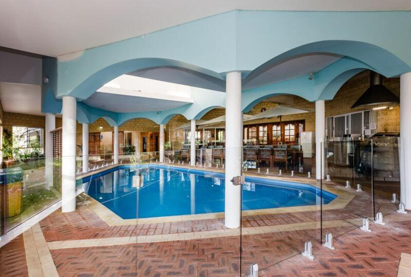 The swimming pool at or near Inn The Tuarts Guest Lodge Busselton Accommodation - Adults Only