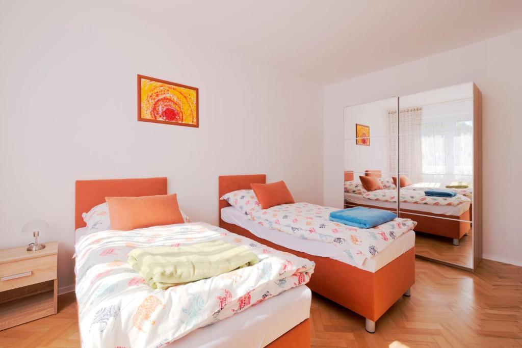 Posteľ alebo postele v izbe v ubytovaní Terasa Capajevova 6 Kosice