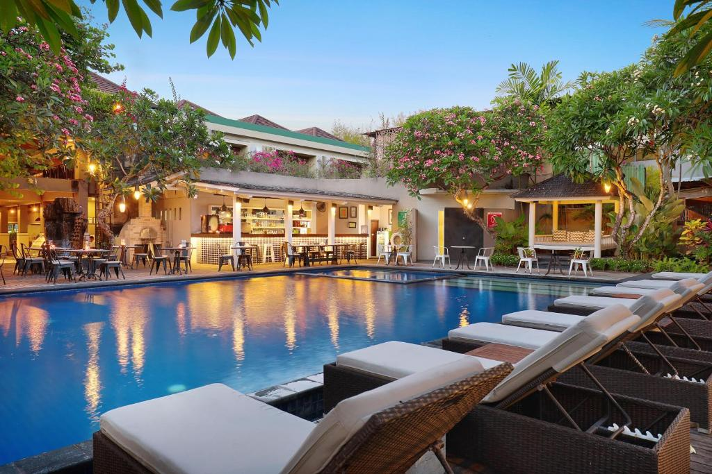 The swimming pool at or near Kamuela Villas and Suites Sanur