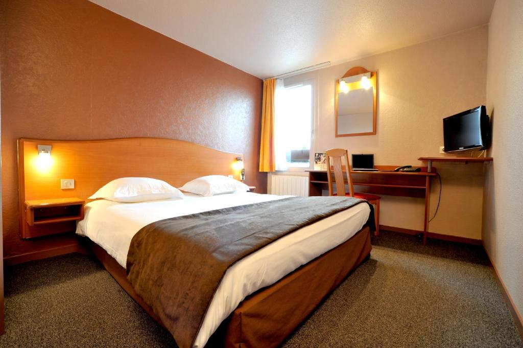 Un ou plusieurs lits dans un hébergement de l'établissement authentic by balladins Valenciennes Aéroport