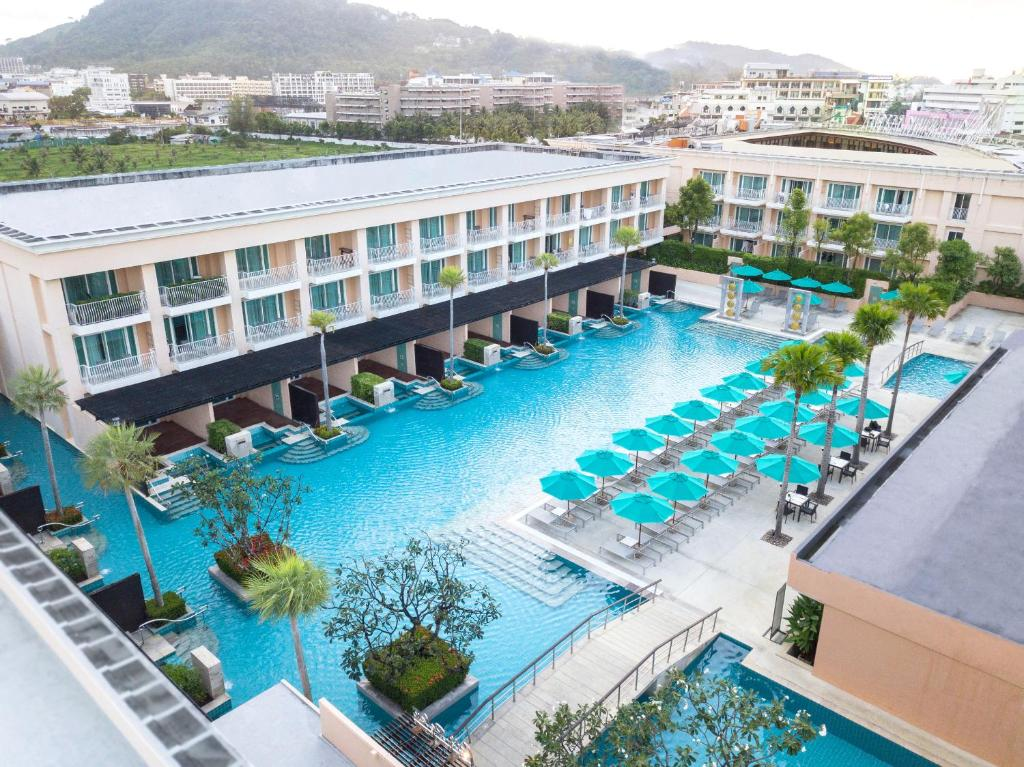 A view of the pool at Millennium Resort Patong Phuket or nearby