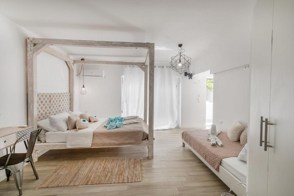 A bed or beds in a room at Kastri Boutique Beach