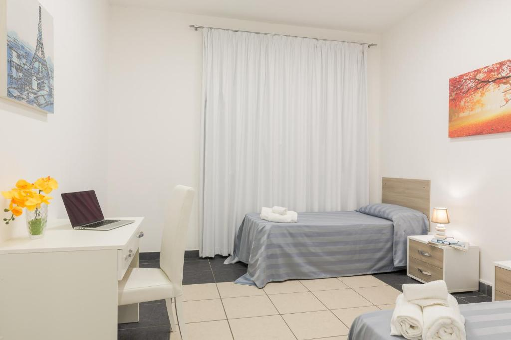 Letto o letti in una camera di Casa per Ferie Don Orione Palermo