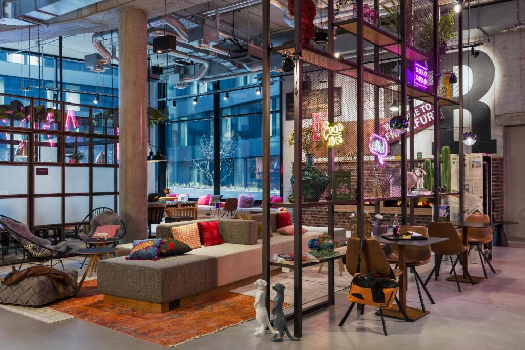 The lounge or bar area at Moxy Frankfurt City Center