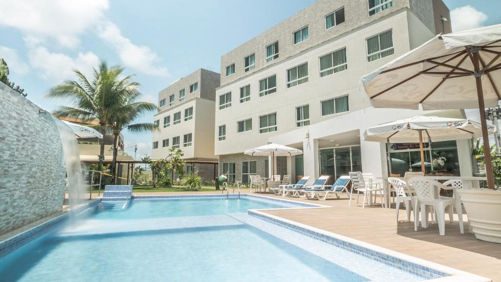 The swimming pool at or close to Hotel Vivenda dos Arrecifes