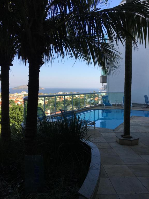 The swimming pool at or near Apartamento linda vista, 200 metros da praia de camboinhas