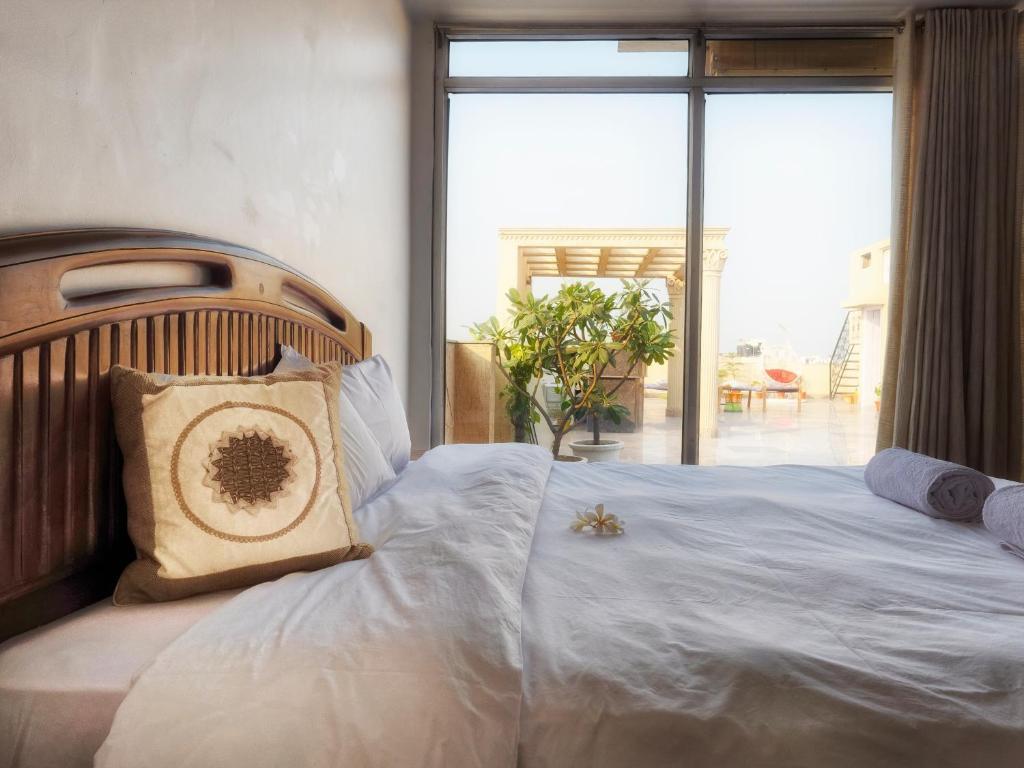 Een bed of bedden in een kamer bij Avatar Living