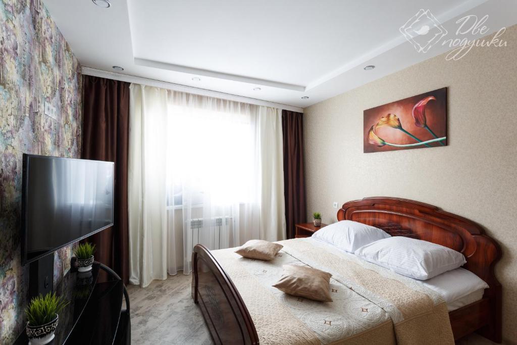 Кровать или кровати в номере Apartment 2Pillows on Gagarina
