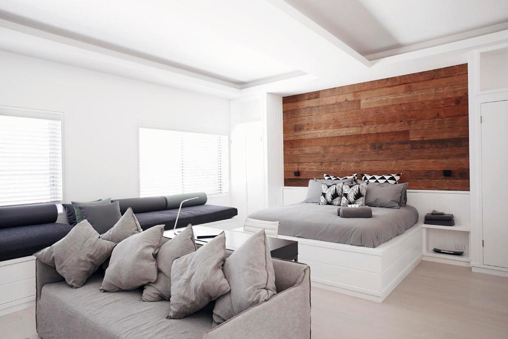 A seating area at Executive Beachside Loft - A Bondi Beach Holiday Home