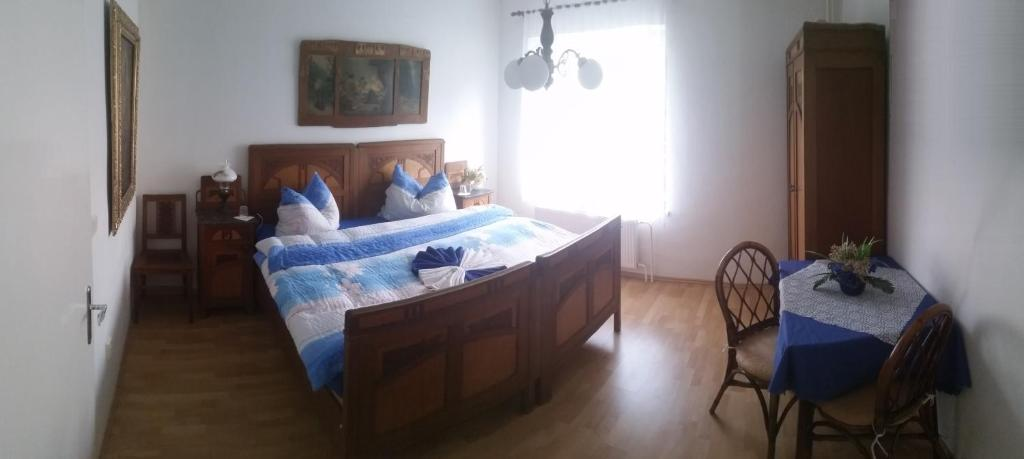 A bed or beds in a room at Vila Patricie