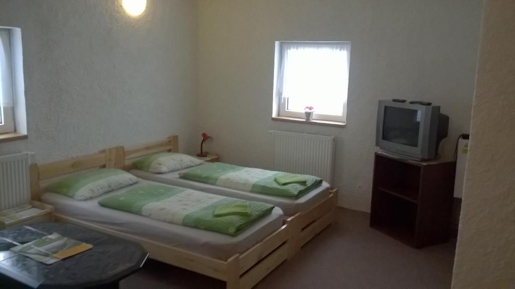 Postel nebo postele na pokoji v ubytování Guest House Honzik