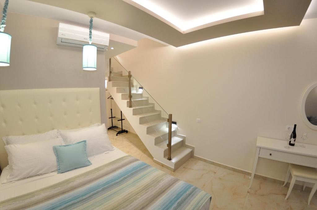 A bed or beds in a room at Agios Gordios Beach Resort