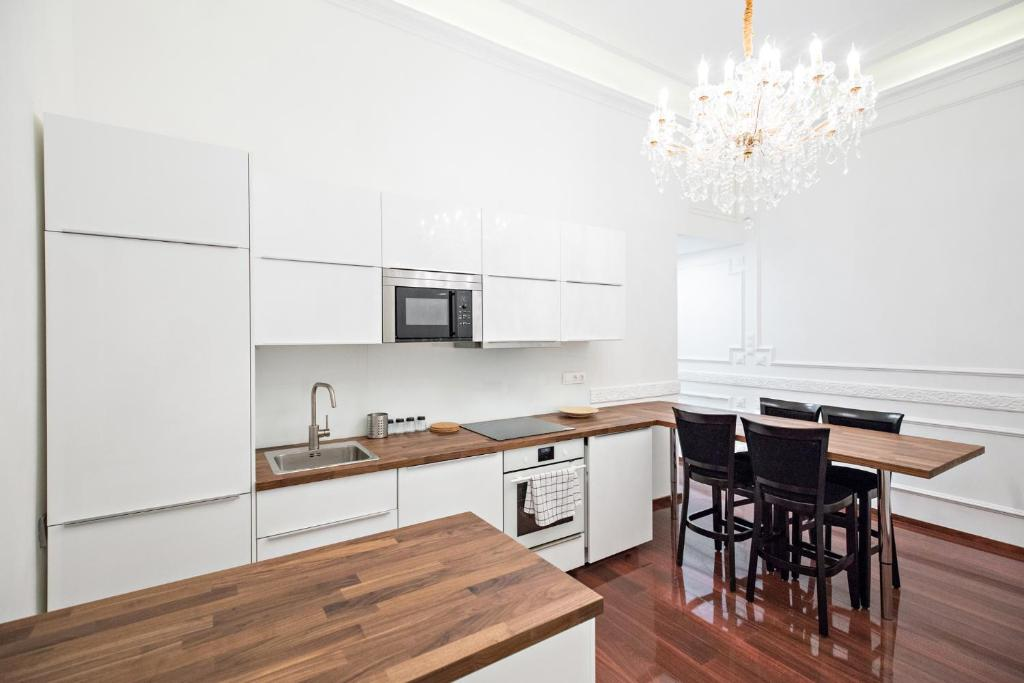 A kitchen or kitchenette at Royal Exclusive Apartments in Centre