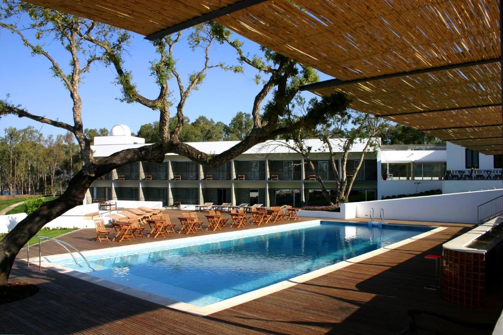 The swimming pool at or near Alentejo Star Hotel - Sao Domingos / Mertola - Duna Parque Hotel Group