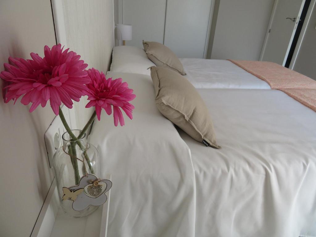 Cama o camas de una habitación en Alcañiz Flats I