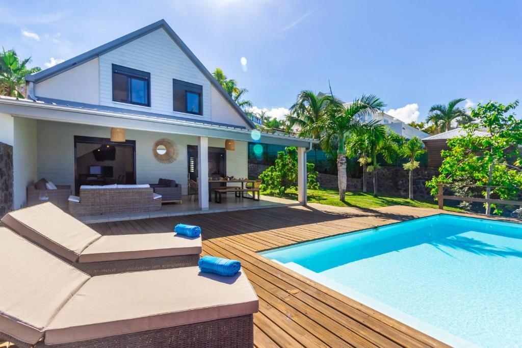 Villa Élysée - Vue mer et piscine à Saint-Gilles