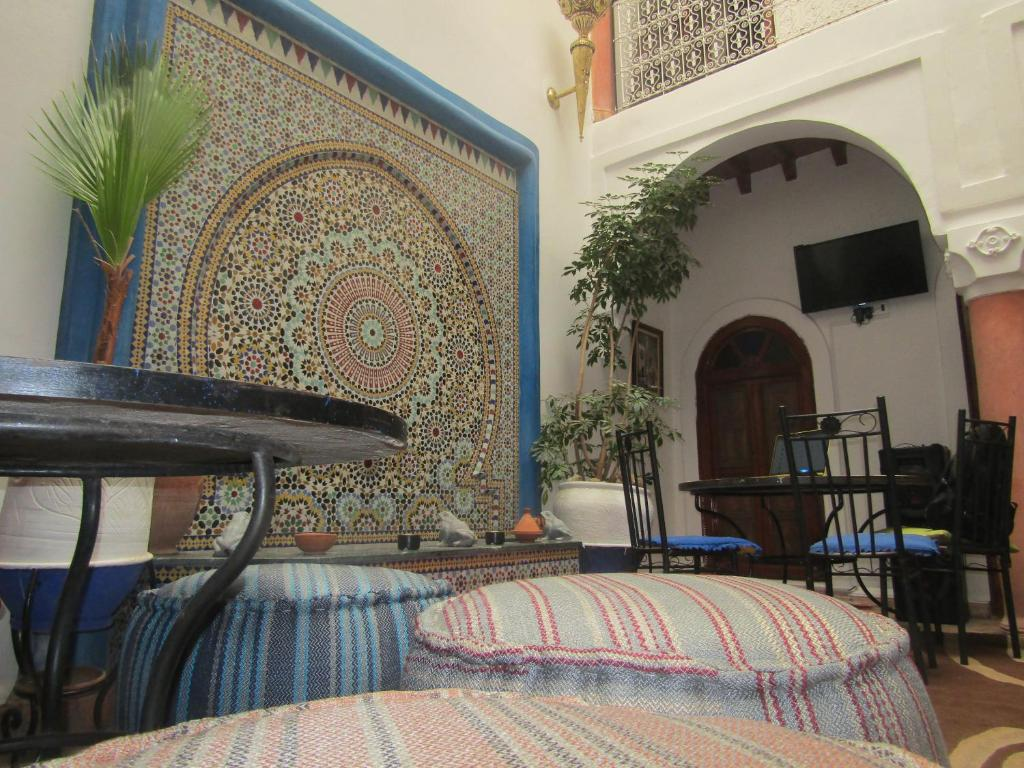 A bed or beds in a room at RIAD FRIENDS