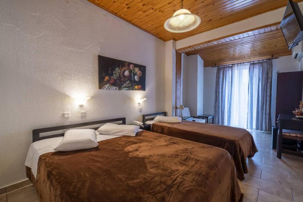 Ένα ή περισσότερα κρεβάτια σε δωμάτιο στο Ξενοδοχείο Λέφας