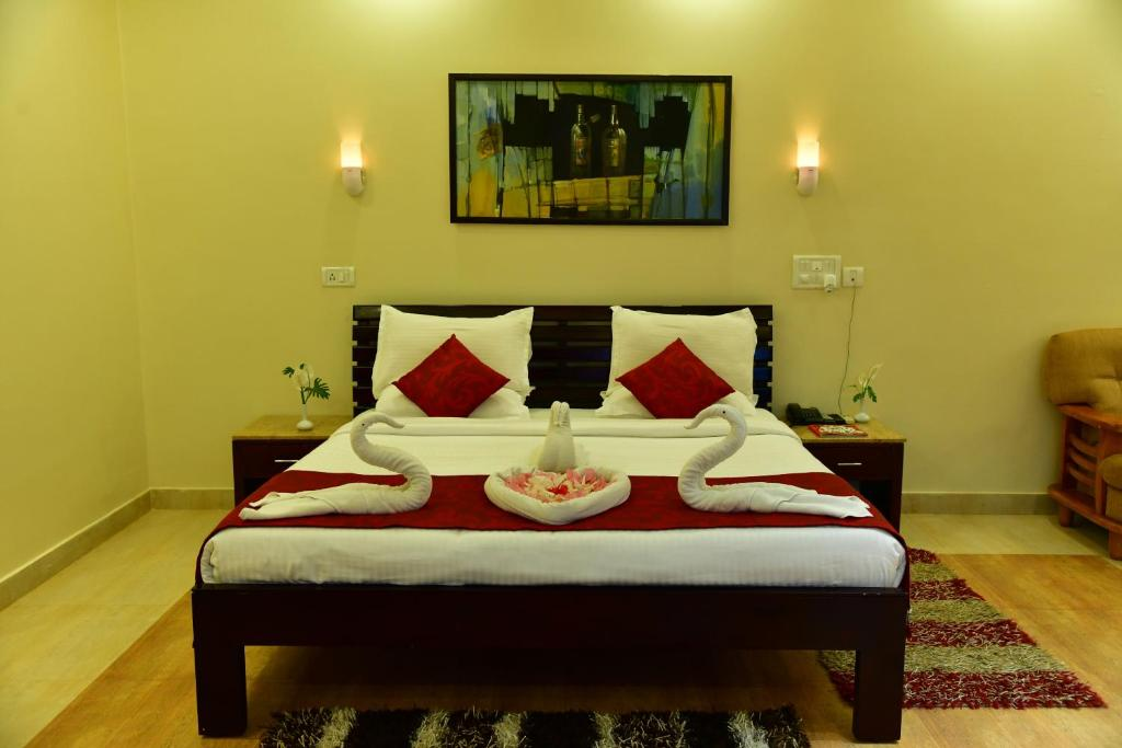 A bed or beds in a room at KSTDC Hotel Mayura Valley View Madikeri