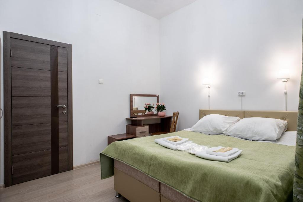 A bed or beds in a room at Adjiutant Mini-hotel