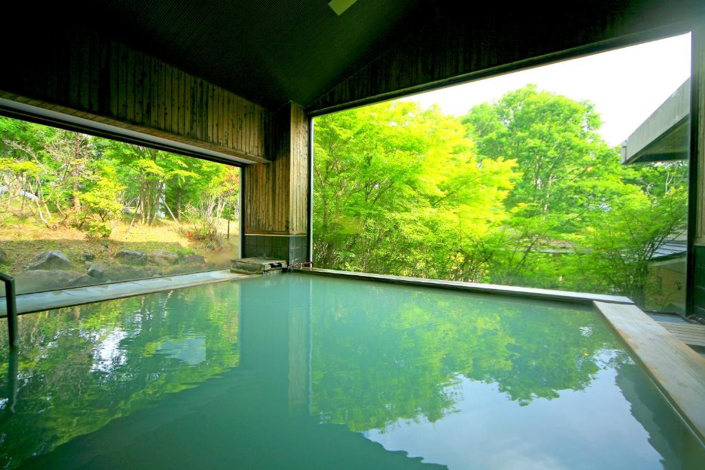 The swimming pool at or close to Hotel Shikisai