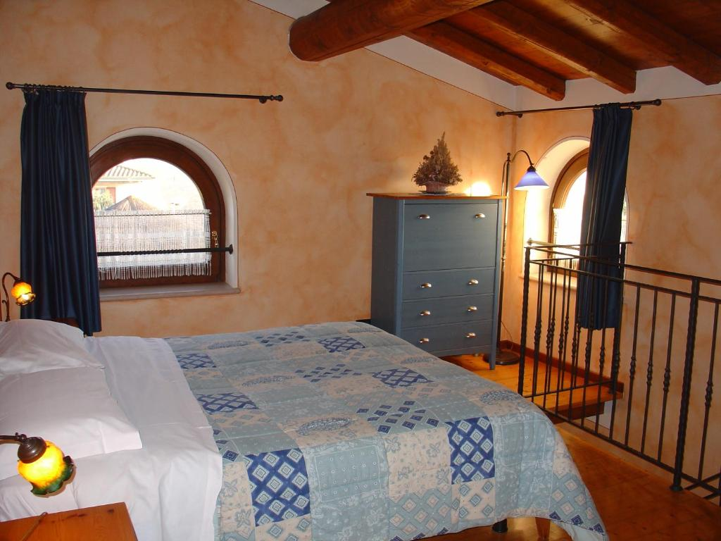 A bed or beds in a room at Agriturismo Gian Galeazzo Visconti