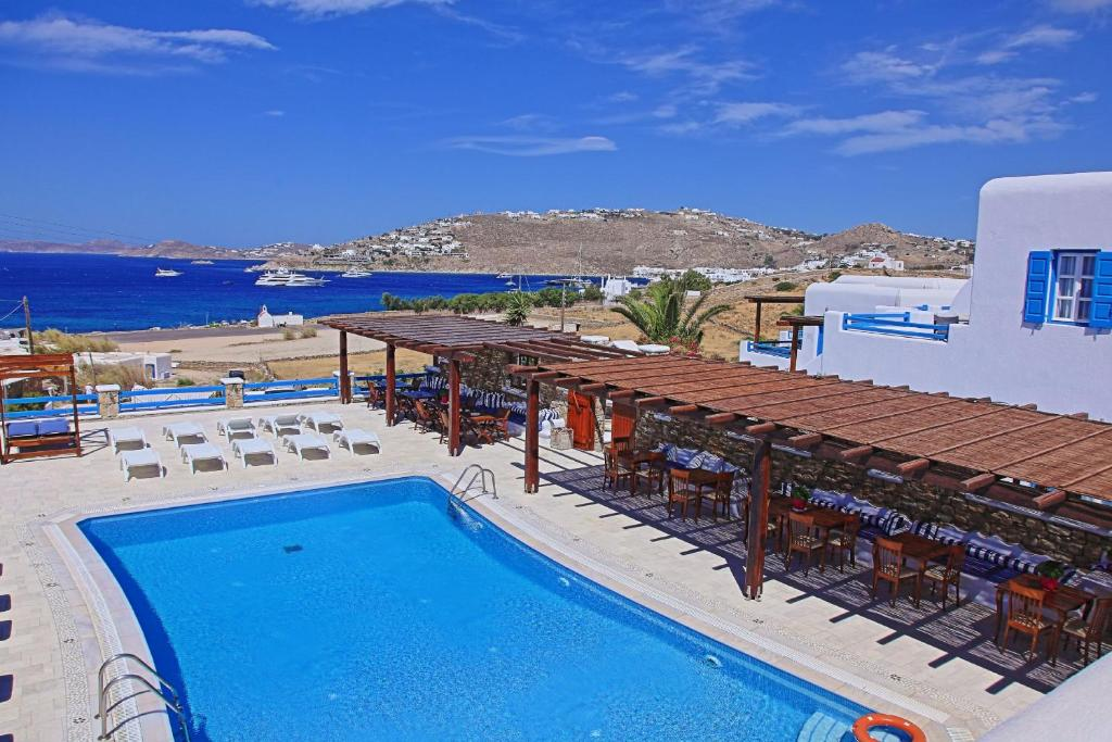 A view of the pool at Maganos Apartments or nearby