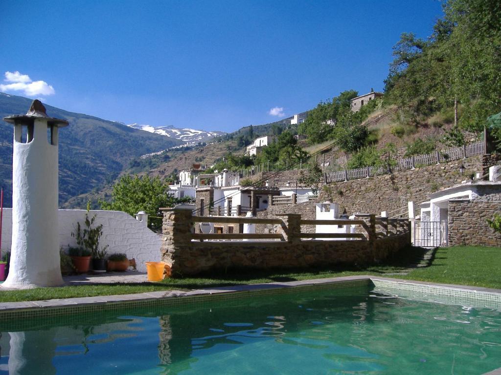 The swimming pool at or near Estrella de las Nieves