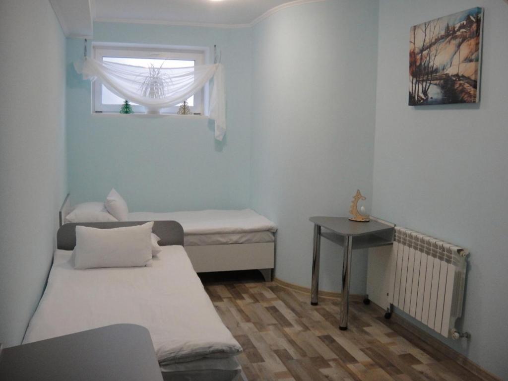 Ліжко або ліжка в номері 12 Months Mini Hotel