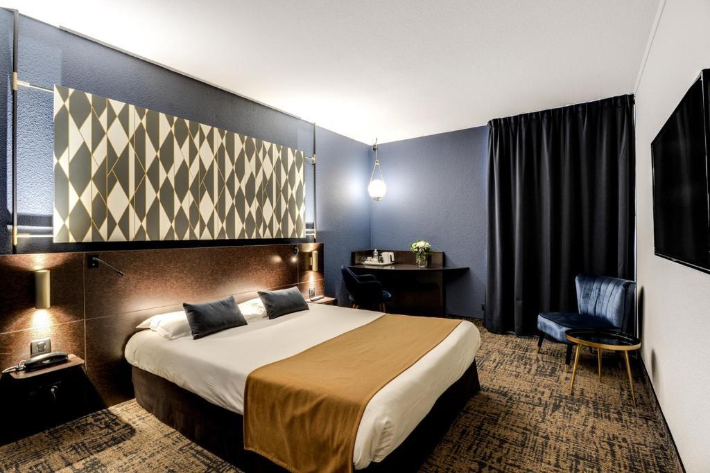 Un ou plusieurs lits dans un hébergement de l'établissement Brit Hotel Du Stade Rennes Ouest