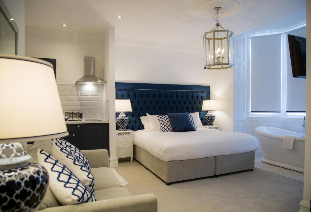 A bed or beds in a room at Winckley Square Hotel