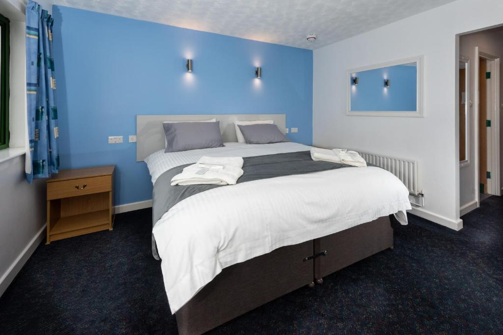 A bed or beds in a room at National Badminton Centre Lodge & Health Club