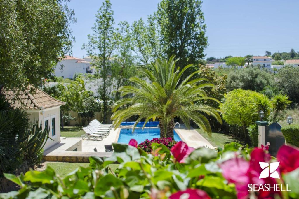 A view of the pool at Villa Caravela or nearby