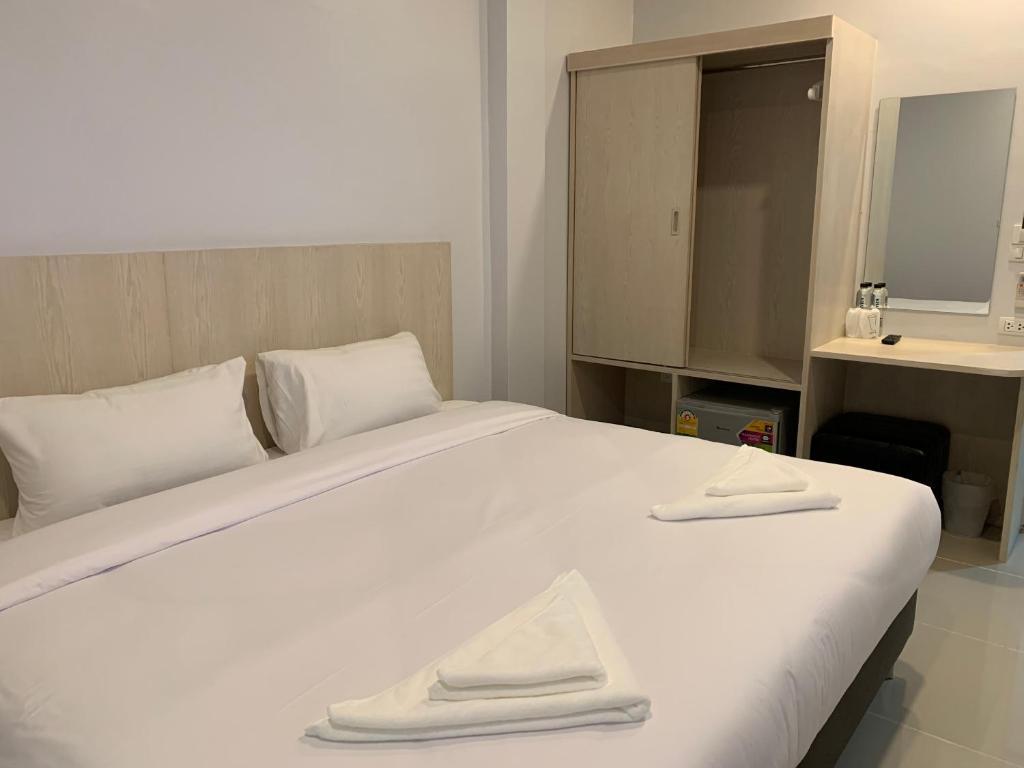 Cama o camas de una habitación en Chiangmun Boutique