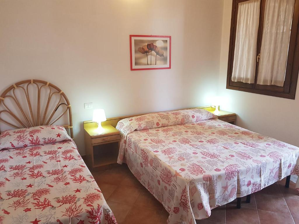 Letto o letti in una camera di Camping Villaggio Egad