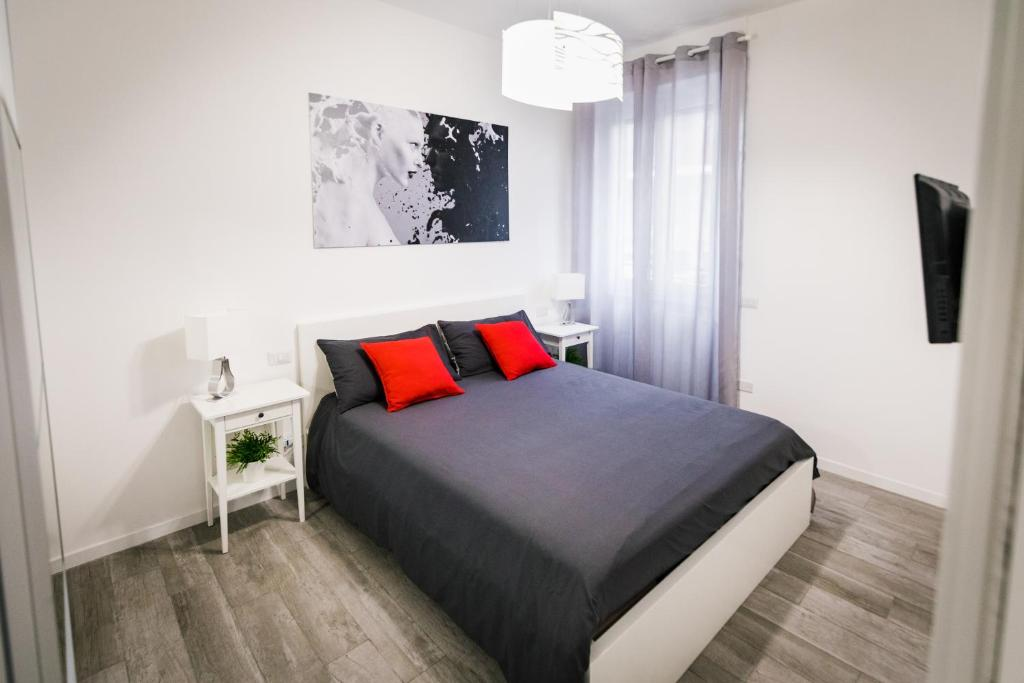 A bed or beds in a room at Appartamento La Fortezza