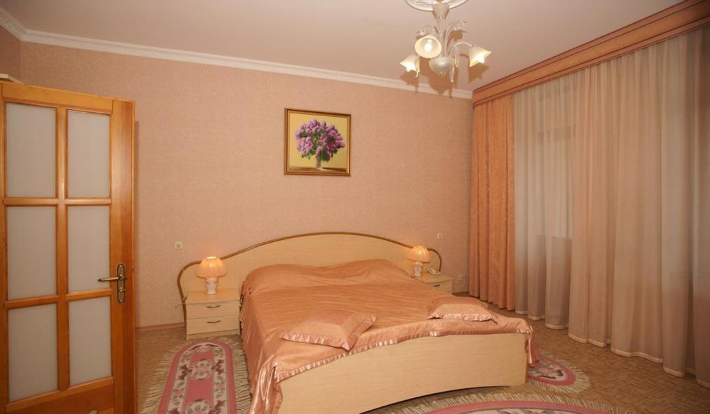 Кровать или кровати в номере Отель Палас