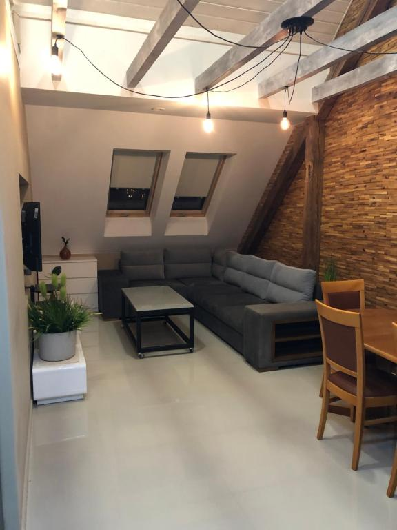 A seating area at Apartament - Loft